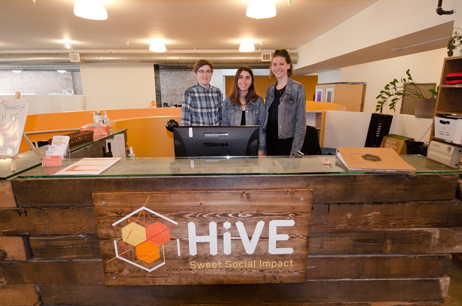 Three HiVE staff standing at the front desk